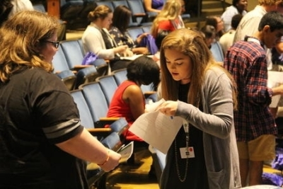 Public and private high school students in 10th through 12th grade trade business cards at the first South Carolina Leadership Conference Wednesday at Lander University.